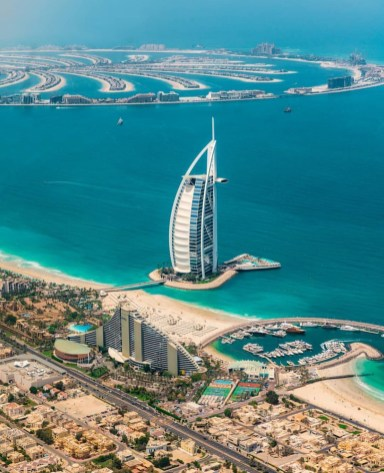 Burj Al Arab, Dubai United Arab Emirates - Azure, Blue, Boat, Body of water, Building, City, Cityscape, Coastal and oceanic landforms, Daytime, Infrastructure, Landscape, Mountain, Nature, Property, Real estate, Sky, Skyscraper, Tower, Tower block, Travel, Tree, Urban design, Water, Water resources, Watercraft