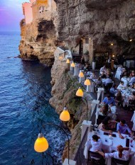Polignano, Italy - Azure, Beach, Blue, Chair, Coastal and oceanic landforms, Leisure, Light, Lighting, Person, Restaurant, Table, Travel, Water, World
