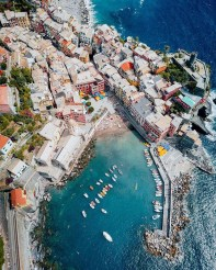 Vernazza, Italy - Azure, Beach, Boat, Body of water, Building, City, Coastal and oceanic landforms, Landscape, Leisure, Travel, Urban design, Vehicle, Water, Water resources, Watercraft, World