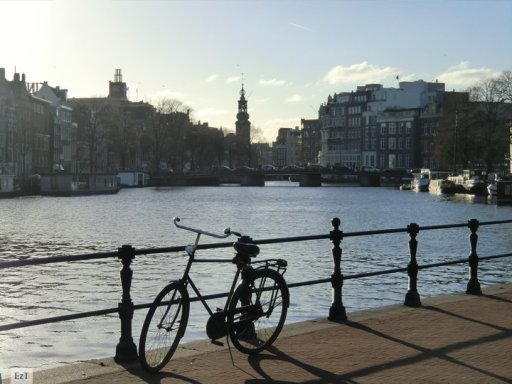 Amstel River with Munttoren at the background