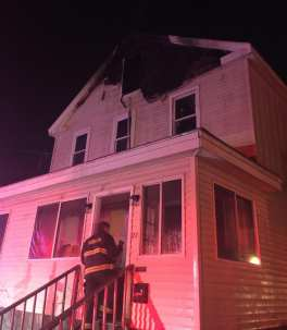 Firefighters put out a 2-alarm house fire at 27 Second Street in Taunton, late Christmas night. (Taunton Fire Department)