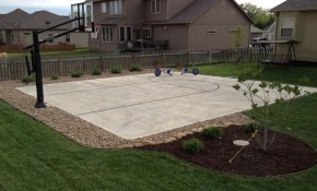 His Pro Dunk Gold Basketball System Sits Nicely Beside The Concrete pertaining to 12 Smart Designs of How to Improve Backyard Basketball Court Ideas