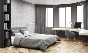 Modern Bedroom And Home Office Corner With Concrete And Gray Stock in Gray Modern Bedroom
