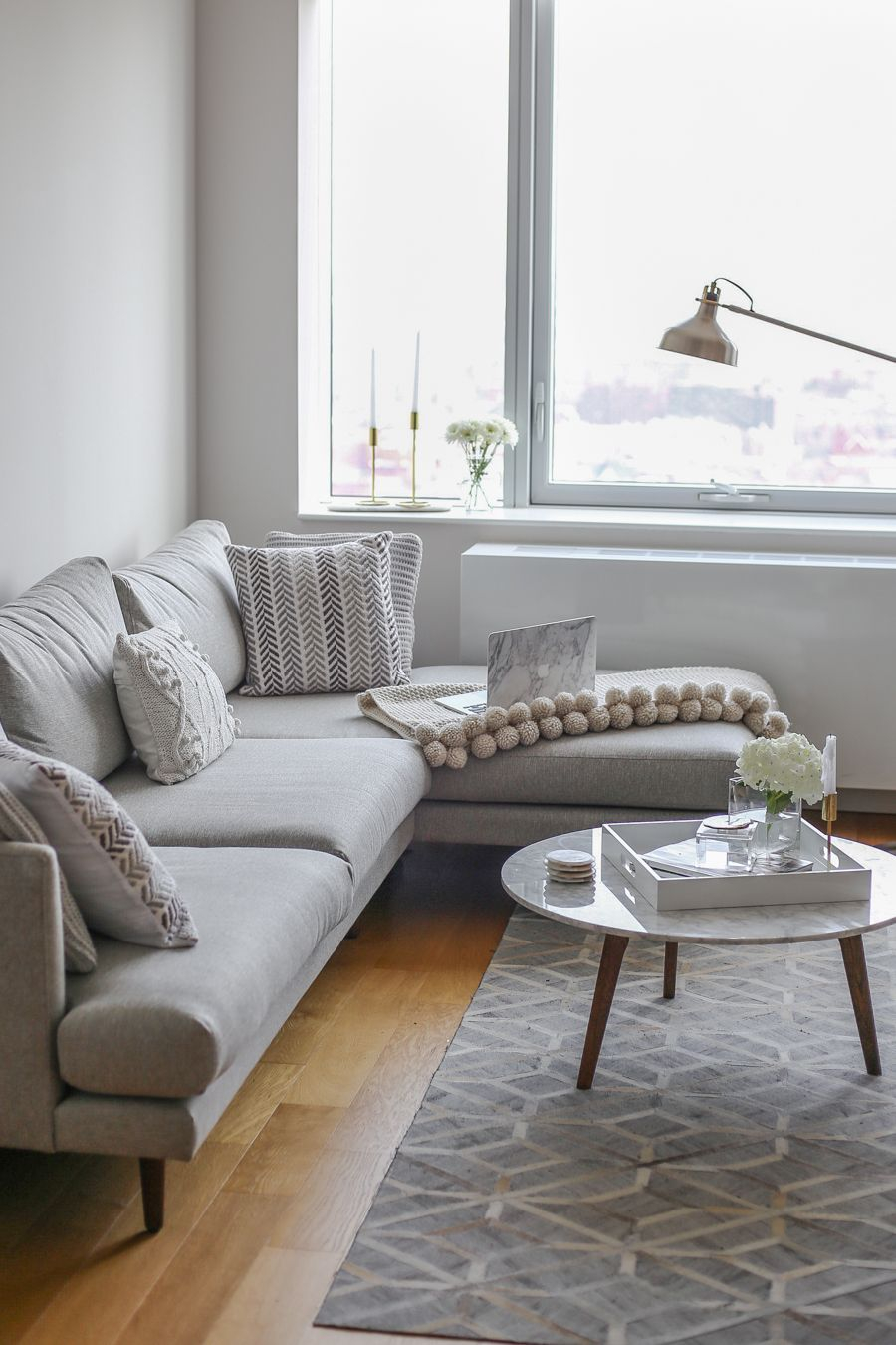 Nyc Living Room Apartment Grey Sectional Sofa With A Marble Coffee intended for 14 Some of the Coolest Tricks of How to Upgrade Living Room Sets Nyc