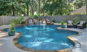 Peaceful Freeform Pool And Waterfall With Tanning Ledge Morehead in Backyards With Pools And Landscaping
