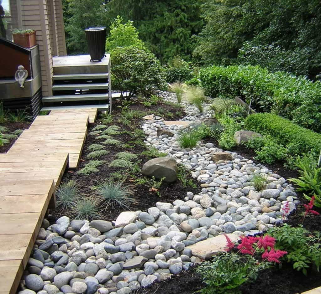 Backyard With River Rock Walkway And Small Shrubs River Rock throughout 13 Clever Ways How to Craft Backyard Landscaping Ideas With Rocks
