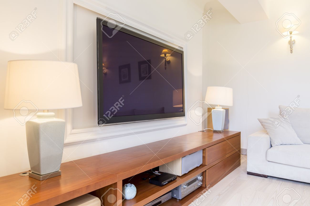 Bright And Spacious Living Room With A Tv Set And A Long Hi Fi within Living Room Set With Free TV