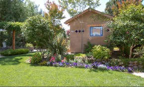 Southwestern Style Shed In A Beautiful Landscaped Backyard Garden pertaining to Beautiful Landscaped Backyards