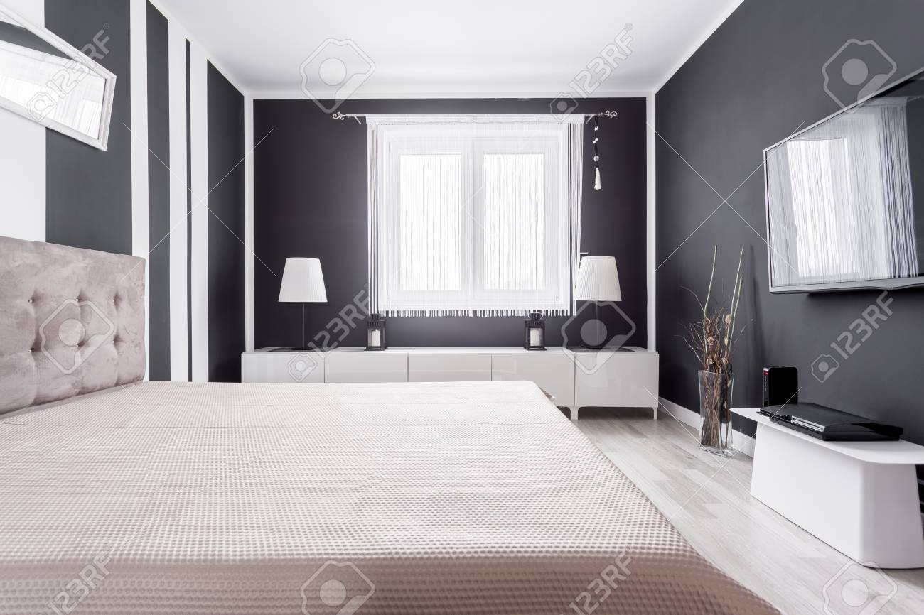 Relax Zone With Bed Tv And Gaming Console In Modern Black Bedroom for Modern Black Bedroom