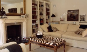 Zebra Print Stool And Cream Sofa In Elegant Living Room With Large regarding Zebra Living Room Set
