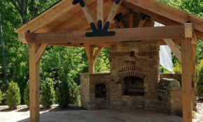 A Backyard Pavilion With A Fireplace Serves As A Multi for Gazebo Ideas For Backyard