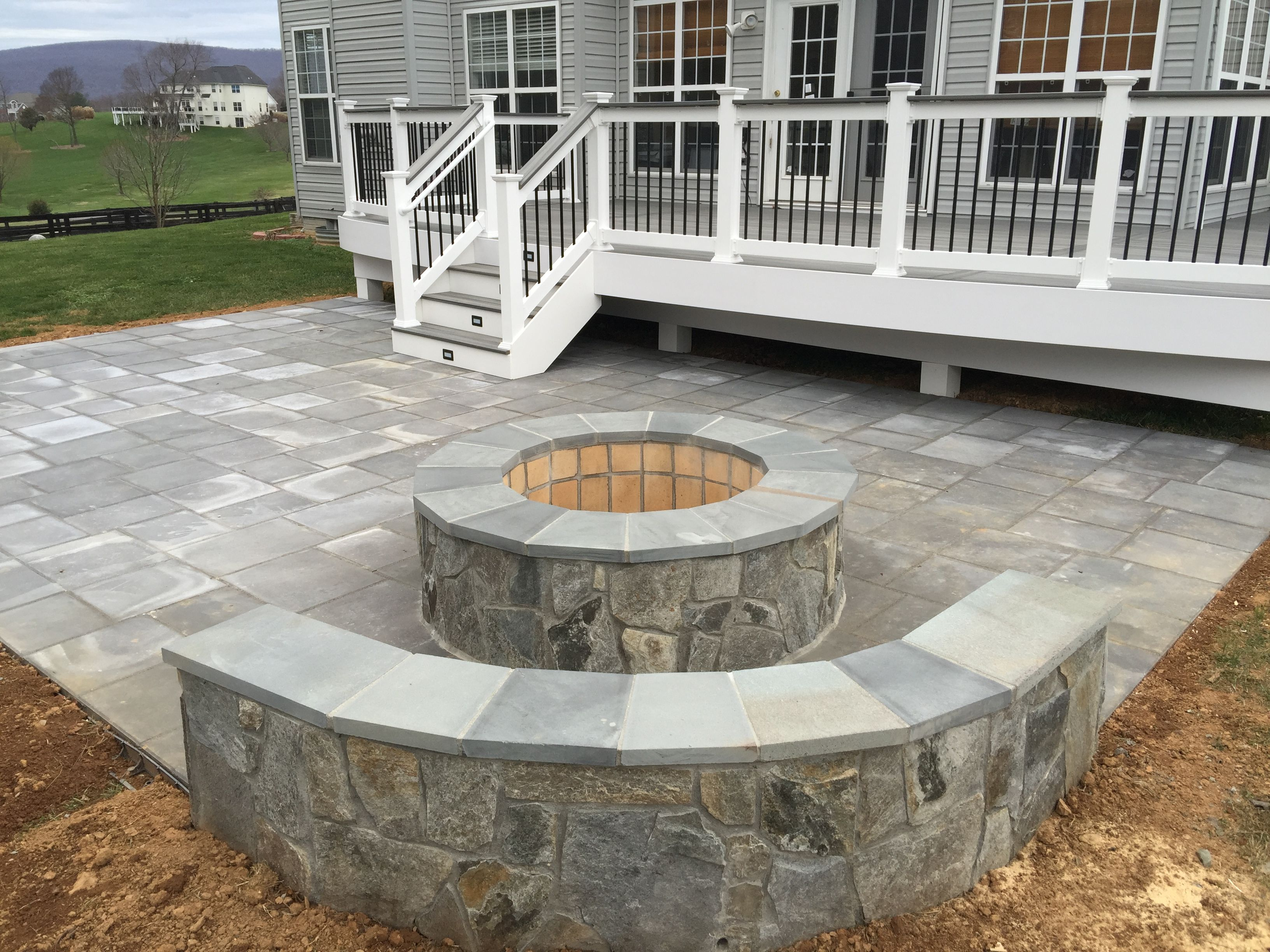 A Beautiful Paver Patio With Stone Seating Walls And A Fire throughout Backyard Stone Ideas