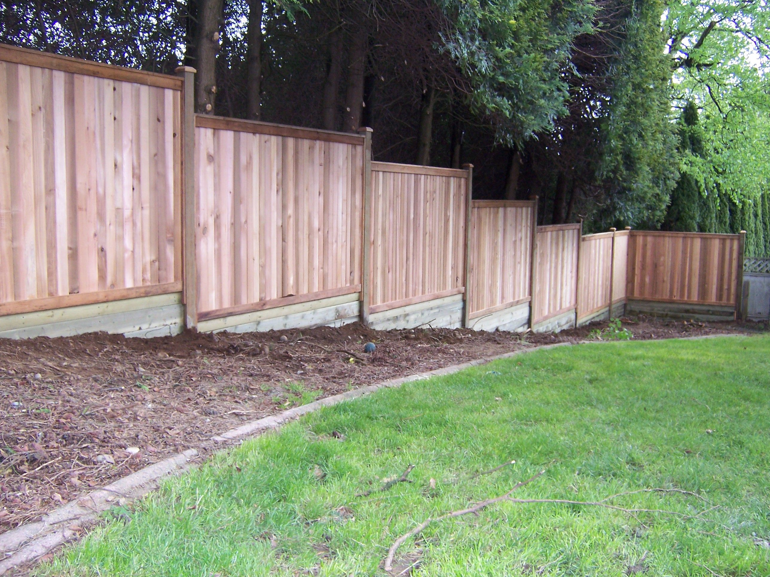 Privacy Fence Building Build A Fence On Sloped Ground Backyard inside 13 Awesome Concepts of How to Make Backyard Fencing Ideas