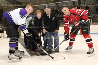 EMS's Kyle Stewart faces off with Fire's Jamie Sullivan. Dropping the puck are Linda Rockwood and Sherman Kropf.