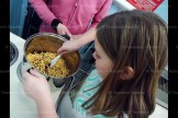 Jenna Van Boekel stirs a pot of chow mein noodles, coconut, peanuts and chocolate together for bird's nest cookies.