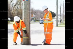 Emmerson Pascal (left) and Tanya Moyer of Ontario Pole Inspection Inc. record the condition of all the hydro poles in Tavistock as part of a contract with Erie Thames Powerlines. Poles are inspected about every three years.