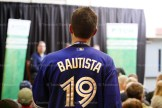 Jeff Schwartzentruber, wearing his #19 Jose Bautista jersey, asks a question of the panel.