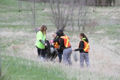 Helping the Tavistock Men's Club clean up the roadside south of the village last Thursday evening were 4-H Club members, from the left, Amanda Witmer, Janet Bruce, Emily Schwartzentruber and Laura Witmer.