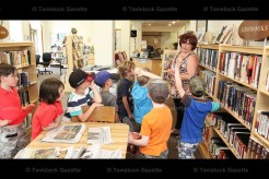 Students of Mrs. Michelle Nahrgang's Grade 1 Class at Tavistock Public School tour the Tavistock Public Library with Librarian Mrs. Deb Schurink (pictured right) last Tuesday morning. Above the boys' group asks questions about the available book selection.