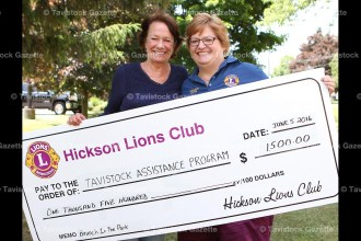 Tavistock Assistance Program (T.A.P.) Director Sharon Walkom accepts a cheque for $1,500 from Hickson Lions' Brunch in the Park committee chairperson Geraldine Claessens of the Hickson Lions Club.
