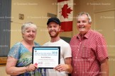 Brenda Wettlaufer receives her award from Agricultural Society President Chad Keller and Mayor Don McKay.