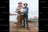 Alan and Sherrill Calder took their favourite home- town paper on their fishing vacation to Frontier Fishing Lodge at Lutsel K'e on Great Slave Lake in the Northwest Territories.
