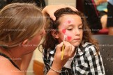 Getting her face painted by Danielle McAuley at the Curious George 75th Birthday Party at the Library last week is Hailey Snider.
