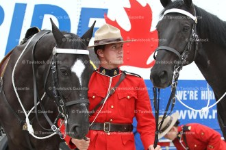 RCMP Constable Harrison Teed of St. Stephen, New Brunswick with horses Teddy (left) and Warren.