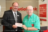 Canadian Transplant Assocation (CTA) National Treasurer Mike Sullivan of Tavistock (right) was pleased to accept a cheque for $3,500 from Scotiabank manager Phil Schaefer recently in support of the Transplant Games held in Toronto from August 8-13. Scotiabank donated $4,500 in total with $500 raised during a barbecue on July 8th with matching funds coming from the local branch.