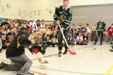 Olli Juolevi of the London Knights tries to score on Sam Patton during a presentation at Tavistock Public School.