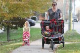 It was a gorgeous day weatherwise on Tuesday, November 1st, 2016. Out enjoying the weather was 3-year-old Nora Hogan pushing her carriage down William Street South along with mom Liana pushing son, Reed.