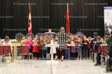 Grade 1 teacher Michelle Nahrgang directs her students in a song during the Remembrance Day Service at Tavistock Public School.