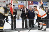 Comrade Harry Lawry drops the puck at the Remembrance Day game between the Tavistock Braves and the Burford Bulldogs. Legion members also in the cloud party were, from the left, Deb Stevely, Susan Pellow, Legion President Jane McKay and Courtney McKay.
