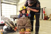 Two classes of students of Tavistock Pre-School enjoyed a day at the firehall last week as Community Safety Officer Jeremy Bartlett explained the duties of a firefighter and let the youngsters dress up and sit in the vehicles. Jack Zehr tries on bunker gear.