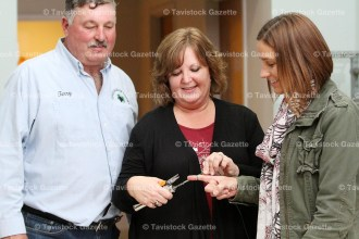 Terry and Bev Yungblut of Greenview Farms, Fonthill, demonstrate a vine tieing tool on Deborah Schippling following the presentation on November 1, 2016 at the Tavistock and Area Horticultural Society meeting.