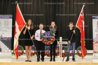 Participating in the Remembrance Service at Tavistock Public School on Friday, November 11, 2016 were, from the left, Grade 8 students Danielle Bast, Izac Blum, Briana Giroux, and Grade 7 student Evan Carey.