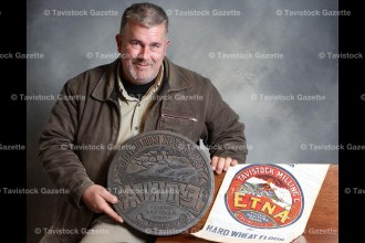 Tavistock collector and furniture refinisher Ron Saunders displays the antique, hand-carved, wooden stamp he acquired recently that was used for printing flour bags for the Tavistock Milling Company around the turn of the 20th century.