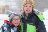 Brothers, Cameron, 4, and Brady Kuiack, 7, are bundled up against the cold and snow on their way back to school Monday morning in Tavistock.