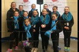 Team Unity Beginner 1 skaters include, in front: Alexis Bell; second row: Lindsay VanderHyden, Avery Brenneman, Kaylee Adam, Annabelle Hendry, Chloe Bell; back row: Coach Tara Wilkins, Ava Panchen-Porchek, Gretta DeWetering, Brinn Gerber, Lilly Bender, and Maddy Adam.