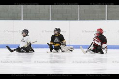 Tavistock Tyke goalies Spencer Otto (left) and Carter Cook (centre) await their turn in the net during the Skills Competition. At right is Ingersoll Express goaltender Evan Young.