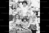 March 30, 1988 - The General Store sponsored an Easter Egg decorating contest. Lois Gascho is shown above with the prizes and winners: from the left, Tommy Dufton, 3; Sandra Nador, 6-1/2; Dawn Boomer, 4; and Jamie Markle, 7.