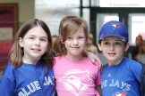 Grade 3 students cheering on the Blue Jays are, from the left, Derika Scheerer, Ruby Harnack and Connor Murray.