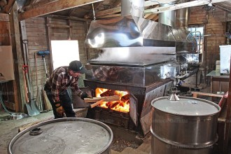 Carman Wettlaufer stokes the fire in his sugar shack during this season's maple syrup run.