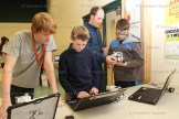Co-op student Simon Vander Borgh (left) helps Gregory Waters with programming while Stratford Northwestern co-op teacher Tony Roes helps Jackson Sim with his model at Hickson School.