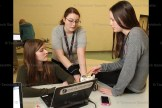 D&D Automation co-op student Micheala Coddingtom (centre) helps Hickson Grade 8 students Megan Fife and Rachel Acres.