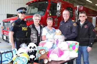 "Accepting the ""Bears, Books and Blankets"" kits from Anna P. Lewis W.I. past president Mary Alice Roth and president Chris Wiffen (centre) are OPP Constable Kris Killoran (left), Hickson Fire Chief Tom Bickle and Tavistock Station Deputy Chief Maury Sauder."