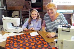 Abby Howe makes a quilt square with her grandmother Linda Howe at the Oxford W.I. 'Big Quilt Bee.'