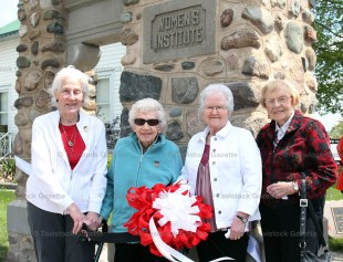Former Tavistock Women's Institute members, from the left, Doris Gladding, Anne Matresky, Shirley Ramseyer and Jean Houghton in front of the restored stone gates originally built in 1929.