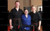 Sensei Tamara Yates (centre) with Black Belt recipients Lisa Griffioen and Josh Kimpel.