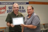 Phil Buzzell receives his Community Achievement Award from EZT Councillor Jeremy Smith.